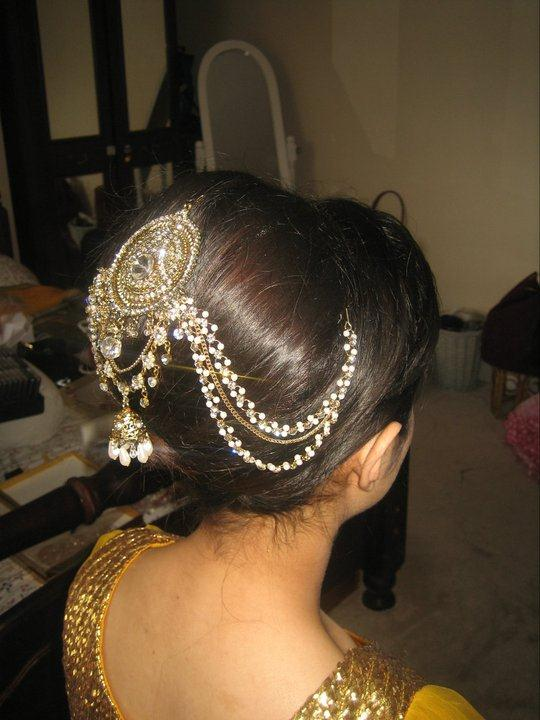 ... hair style bun style or joura style id most famous style among bridals